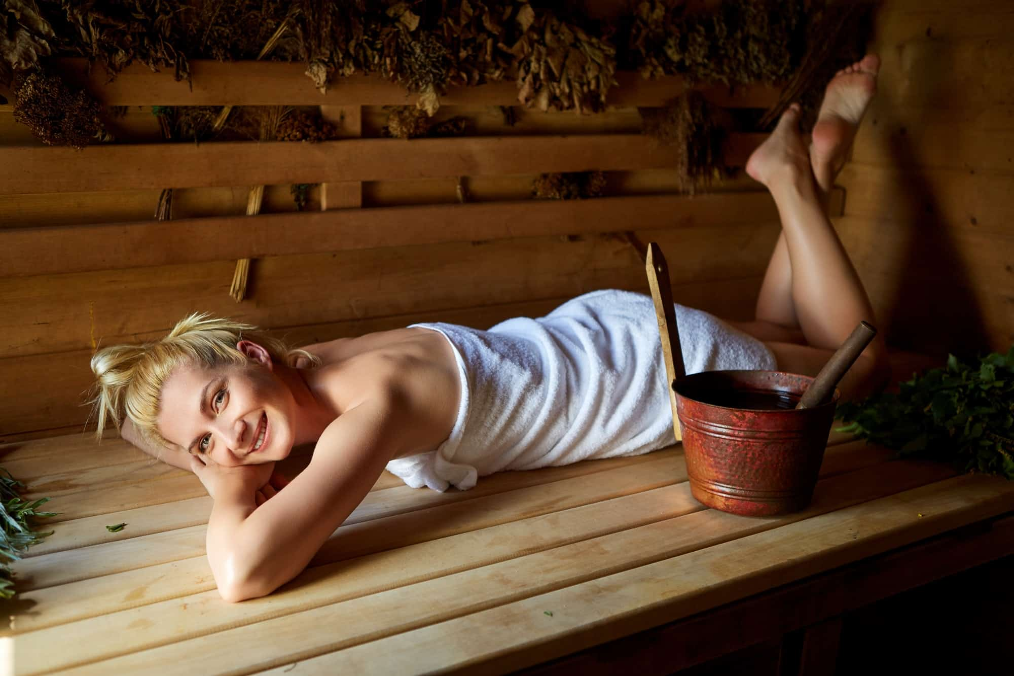 beautiful girl relaxing in sauna